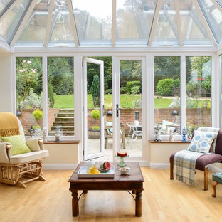 Inspiration for a contemporary conservatory in Hampshire with laminate floors.