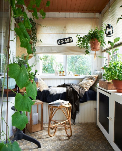 Eclectic Porch by Joanna Thornhill Interiors