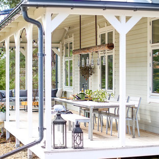 Mid-sized danish front porch idea with a roof extension
