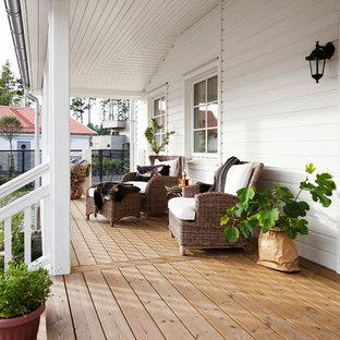 Inspiration för stora lantliga innätade verandor framför huset