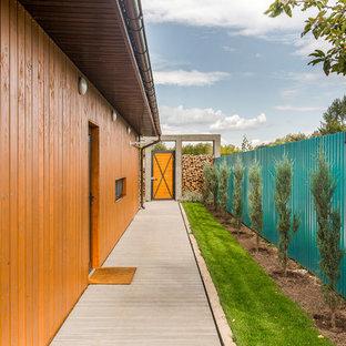 Свежая идея для дизайна: веранда на боковом дворе в современном стиле - отличное фото интерьера