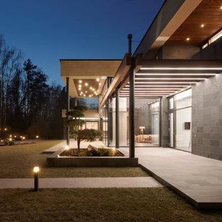 Неиссякаемый источник вдохновения для домашнего уюта: большая веранда в современном стиле с навесом