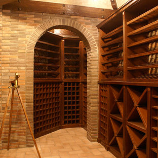 Design ideas for a large classic wine cellar in Moscow with brick flooring and storage racks.