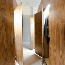 Contemporary Closet by Moon Design + Build