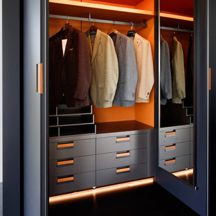 Inspiration for a medium sized contemporary standard wardrobe for men in London.