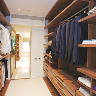 Photo of a contemporary walk-in wardrobe for men in London with open cabinets and medium wood cabinets.