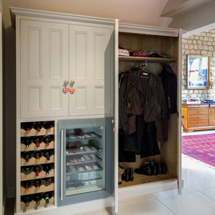 Rural gender neutral wardrobe in Other with recessed-panel cabinets and white cabinets.