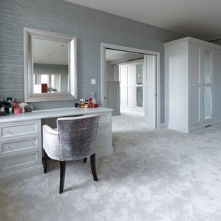 Large contemporary gender neutral dressing room in Hertfordshire with recessed-panel cabinets, grey cabinets and carpet.