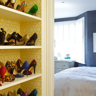 This is an example of an eclectic storage and wardrobe in London with open cabinets.