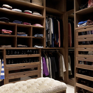 Inspiration for a timeless walk-in closet remodel in Wiltshire with open cabinets and medium tone wood cabinets
