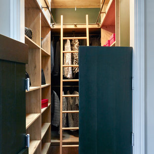 Photo of a small contemporary dressing room for men in London with open cabinets, medium wood cabinets, dark hardwood flooring and brown floors.