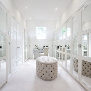 Example of a large classic women's carpeted dressing room design in Berkshire with white cabinets
