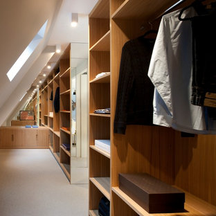 Gentil Example Of A Large Trendy Menu0027s Carpeted Walk In Closet Design In London  With Medium