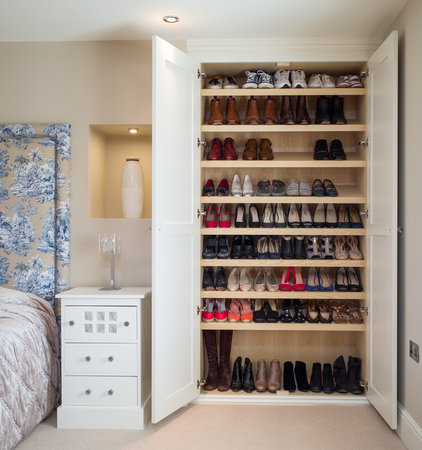 Transitional Closet by Acastrian Bespoke Fitted Furniture