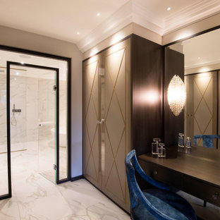 Inspiration for a mid-sized modern gender-neutral marble floor and white floor dressing room remodel in West Midlands
