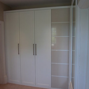 Example of a small trendy closet design in London