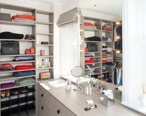 Example Of A Trendy Walk In Closet Design In London With Gray Cabinets