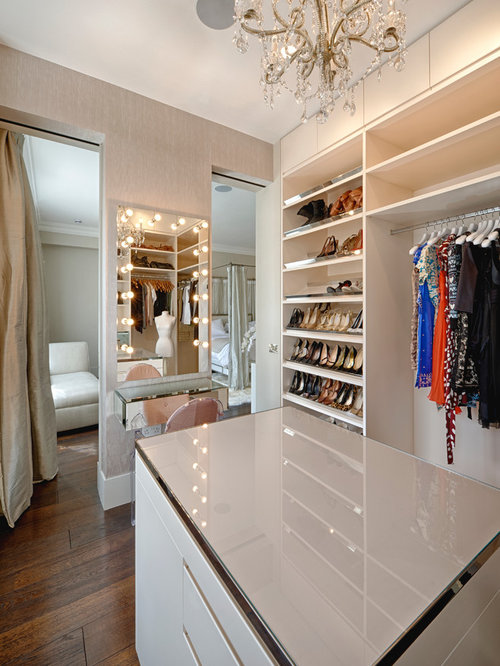 Contemporary Dressing Room In London With White Cabinets And Dark Hardwood  Flooring.