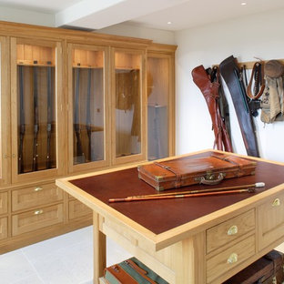 Mid-sized traditional storage and wardrobe in London with raised-panel cabinets, medium wood cabinets and limestone floors.