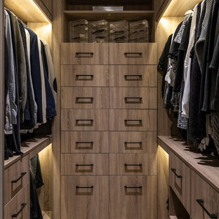 Design ideas for a medium sized contemporary gender neutral walk-in wardrobe in London with flat-panel cabinets, light wood cabinets, light hardwood flooring and brown floors.