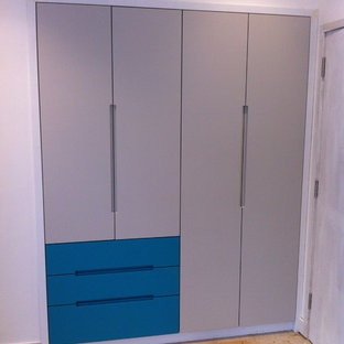 turquoise grab handle wardrobe with LED lighting and walnut interiors