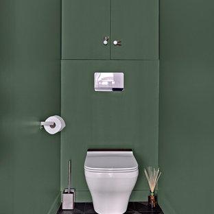 Idee per un piccolo bagno di servizio design con ante a filo, ante verdi, WC sospeso, lastra di pietra e pavimento grigio