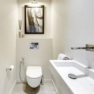 Ispirazione per un grande bagno di servizio classico con ante lisce, ante grigie, WC sospeso, piastrelle grigie, piastrelle in ceramica, pareti grigie, pavimento con piastrelle in ceramica, lavabo a bacinella, top in cemento, pavimento grigio e top grigio