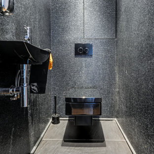 Inspiration for a large contemporary cloakroom in Paris with a wall mounted toilet, grey walls, a wall-mounted sink and slate flooring.