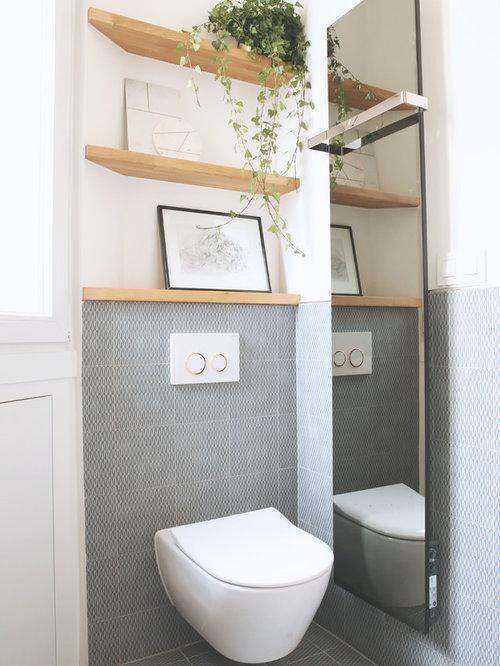exemple de wc et toilettes scandinaves avec un wc suspendu un carrelage gris un