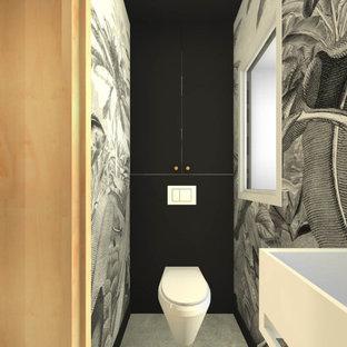 Идея дизайна: маленький туалет в современном стиле с фасадами с декоративным кантом, черными фасадами, инсталляцией, белой плиткой, терракотовой плиткой, черными стенами, бетонным полом, подвесной раковиной, серым полом, белой столешницей и встроенной тумбой