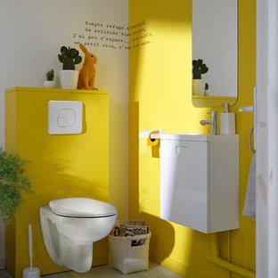 Idées déco pour un WC et toilettes moderne de taille moyenne avec un WC suspendu et un mur jaune.