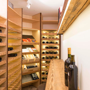 Small rustic wine cellar in Munich with display racks.