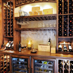 traditional wine cellar by Elevation Architectural Studios