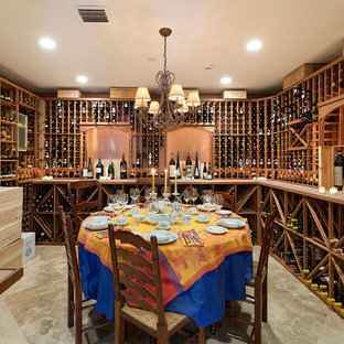 Example of a mid-sized classic beige floor and porcelain tile wine cellar design in Other with diamond bins