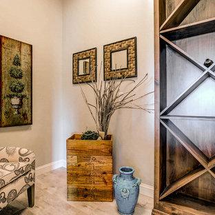 Imagen de bodega minimalista, pequeña, con suelo de pizarra, botelleros de rombos y suelo beige