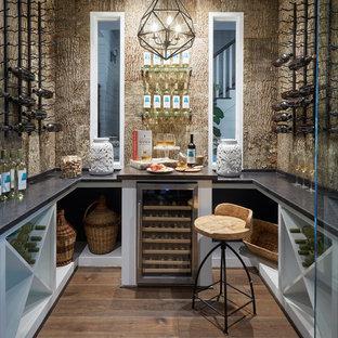 Medium sized traditional wine cellar in Houston with dark hardwood flooring, cube storage and brown floors.