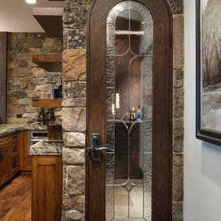 Small mountain style travertine floor and beige floor wine cellar photo in Salt Lake City