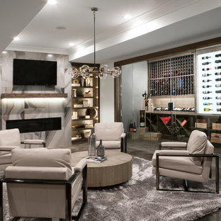 Inspiration for a coastal concrete floor and gray floor wine cellar remodel in Nashville with display racks