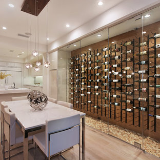 Contemporary wine cellar in Orange County with display racks and yellow floors.