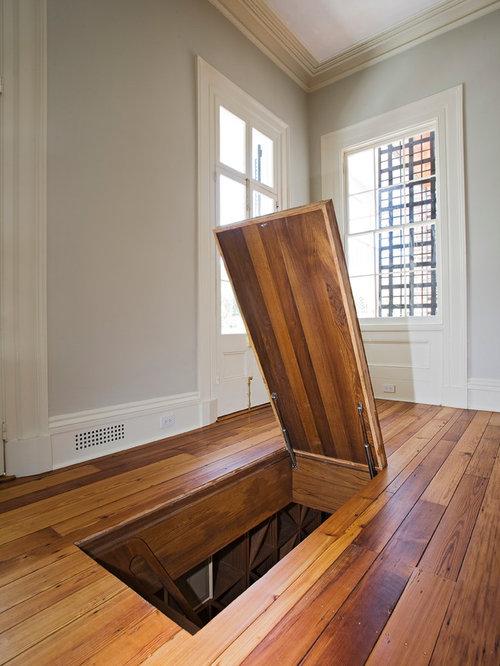 Mid Sized Traditional Medium Tone Wood Floor Wine Cellar Idea In Charleston With Diamond Bins