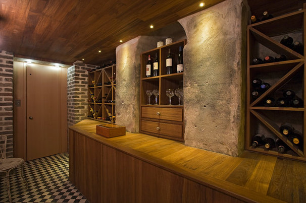 Traditional Wine Cellar by Morris Architecture, llc