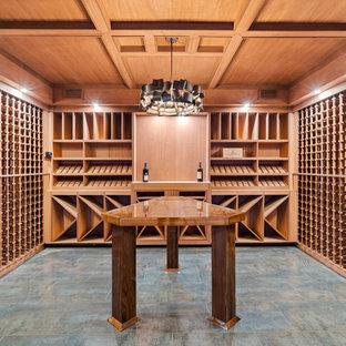 Idéer för mellanstora funkis vinkällare, med klinkergolv i porslin, vinhyllor och flerfärgat golv