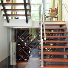 Contemporary Wine Cellar by First Impression Photography