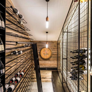 Design ideas for a contemporary wine cellar in Brisbane with storage racks.