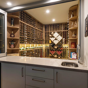 This is an example of a contemporary wine cellar in Sydney with storage racks.