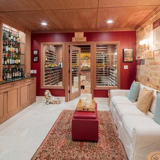 Ejemplo de bodega clásica renovada, grande, con suelo de piedra caliza, suelo beige y botelleros