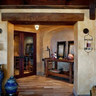Foto de bodega tradicional renovada, de tamaño medio, con suelo de madera en tonos medios, botelleros y suelo marrón