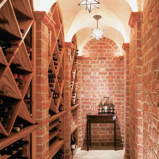 Diseño de bodega clásica con suelo de baldosas de terracota y botelleros de rombos