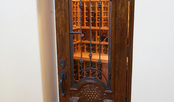 Arched Wine Cellar Door with Glass Insert and Wrought Iron Bars