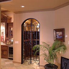 Traditional Wine Cellar by Hughes Edwards Builders